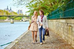 Couple in Paris, on the Seine embankment Royalty Free Stock Photography