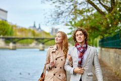 Couple in Paris, on the Seine embankment Stock Photo