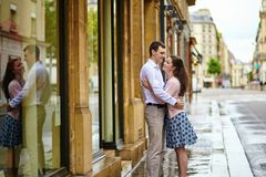 Couple in Paris walking on a rainy day Stock Image