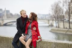 Couple at the Parisian embankment at misty day Stock Photos