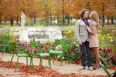 Couple in Parisian park at fall Royalty Free Stock Image