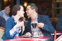 Couple in a Parisian street cafe Stock Photography