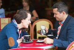 Couple in a Parisian street cafe Royalty Free Stock Photo