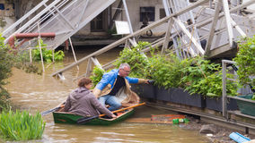 The couple of parisians on the Seine river in flood, Paris. Royalty Free Stock Images