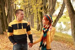 Couple in park. Beautiful young couple walking in autumn park Royalty Free Stock Photo