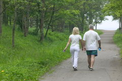 Couple in park. Elderly pair on walk in park Royalty Free Stock Photos