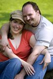 Couple in park. Cute couple on a date sitting under the tree Stock Photo