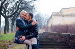 Couple in the park. Near the stairs royalty free stock image