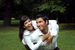 Couple park. Young couple having fun in a park royalty free stock photos