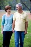 Couple at the park. Senior happy couple walking at the park royalty free stock photo