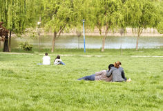 Couple in the park stock photography