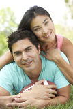 Couple In Park With American Football Stock Photos