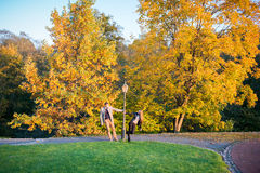 Couple in park at autumn Stock Images