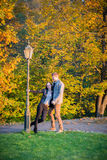 Couple in park at autumn Royalty Free Stock Images
