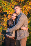 Couple in park at autumn Stock Photography