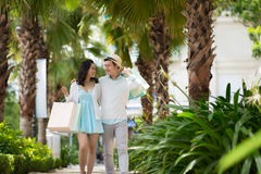 Couple in the park. Beautiful Vietnamese couple in love walking in the park after shopping Stock Image