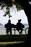 Couple on park bench. Vertical stock photography
