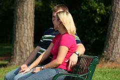 Couple on a park bench Royalty Free Stock Photography