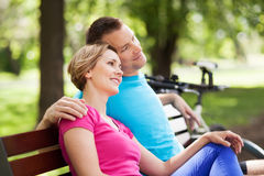 Couple on park bench Stock Photo