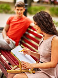 Couple  at park on bench Stock Photos