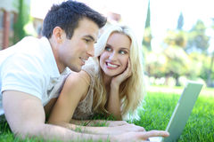 Couple in Park with Computer Royalty Free Stock Images