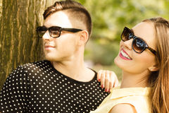 Couple in park getting close. Royalty Free Stock Images