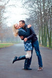 Couple in the park. Handsome couple hugging in the park royalty free stock image