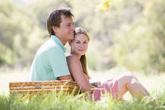 Couple at park having a picnic and smiling royalty free stock image