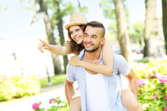 Couple in the park pointing to the camera Royalty Free Stock Image