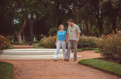 Couple in park of roses Royalty Free Stock Image