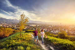 Couple in the park at sunset city view Stock Photography