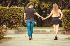 Couple in park taking walk. Royalty Free Stock Photos