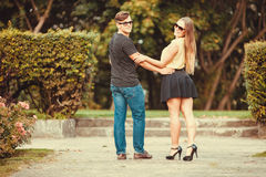 Couple in park taking walk. Royalty Free Stock Image