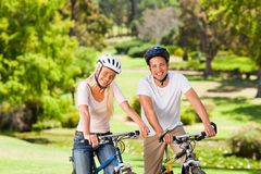 Couple in the park with their bikes Royalty Free Stock Photos