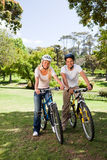 Couple in the park with their bikes Stock Images