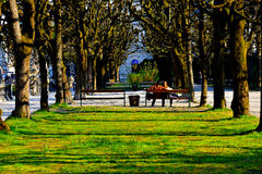 Couple in the parks. A young couple sitting in the Mirabell parks, Salzburg Stock Photography