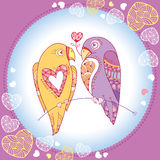 Couple of parrots in love in the round frame with ornate hearts.  Royalty Free Stock Photography