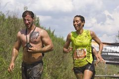 Couple of participants at an Italian Mud Run Royalty Free Stock Images