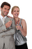 Couple at a party. Formally dressed couple at a party Stock Photo
