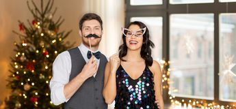 Couple with party props having fun on christmas stock images