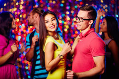 Couple at party. Young couple dancing at nightclub Stock Photos