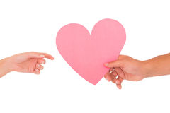 Couple passing a paper heart Royalty Free Stock Photo