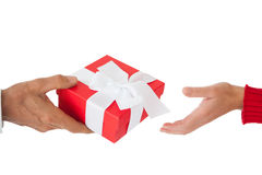 Couple passing a wrapped gift Stock Photo