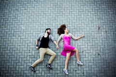 Couple on pavement Stock Photos