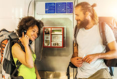 Couple on pay phone laughing Stock Image