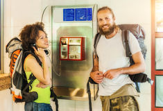 Couple on pay phone laughing Royalty Free Stock Photography