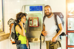 Couple on pay phone laughing Royalty Free Stock Photo