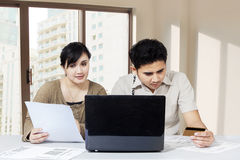 Couple paying bill online Stock Images