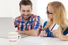 Couple paying bills Royalty Free Stock Images