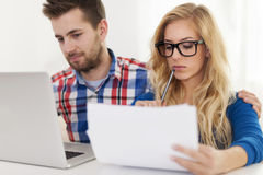 Couple paying bills Royalty Free Stock Image